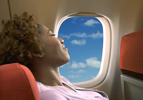 Woman sleeping on airplane   Original Filename: 200177165-001.jpg